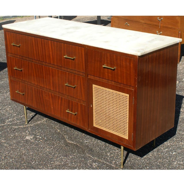 Vintage cane marble dresser. White marble with 4 striped mahogany drawers and a cane paneled cabinet. Brass pulls.