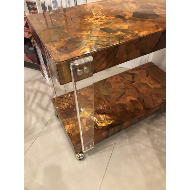 Lovely vintage Brutalist bar cart with mixed metals patchwork including brass and copper and Lucite sides. Lovely new...