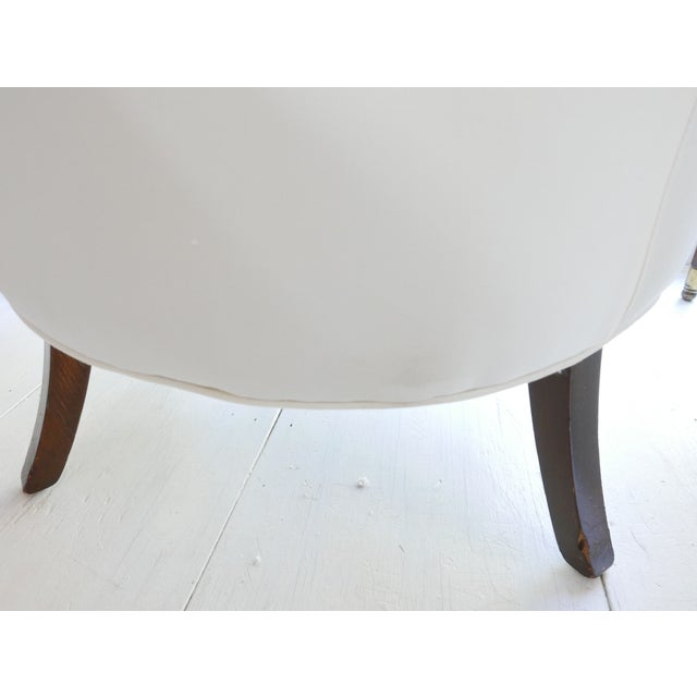 These armchairs have an amazing mid-century mod shape along with classical detail and brass mounts on the legs. The...