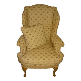 Gold-Colored Upholstered Wingback Chair