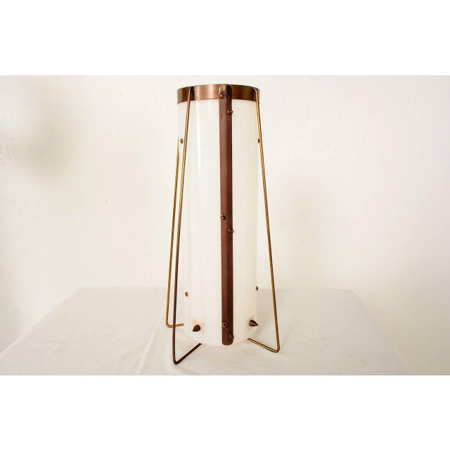 For your consideration a vintage table lamp constructed with a white acrylic cylinder with brass accent hardware. No...