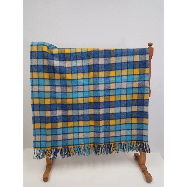Wool Throw Blues and Yellow Squares - Made in England A versatile throw in a squares design. The colors are blues and...