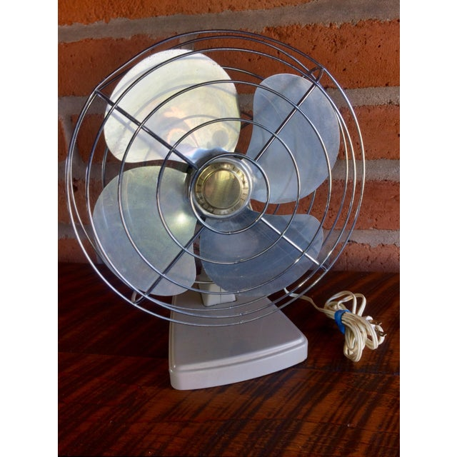 A great Mid-Century Modern fan, it makes a True Industrial Statement! All metal, in clean vintage condition and good...