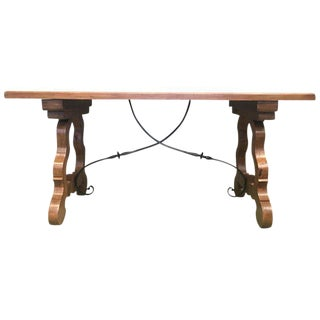 Early 20th Century Spanish Walnut Trestle Table and Forged Iron Stretcher. Desk For Sale