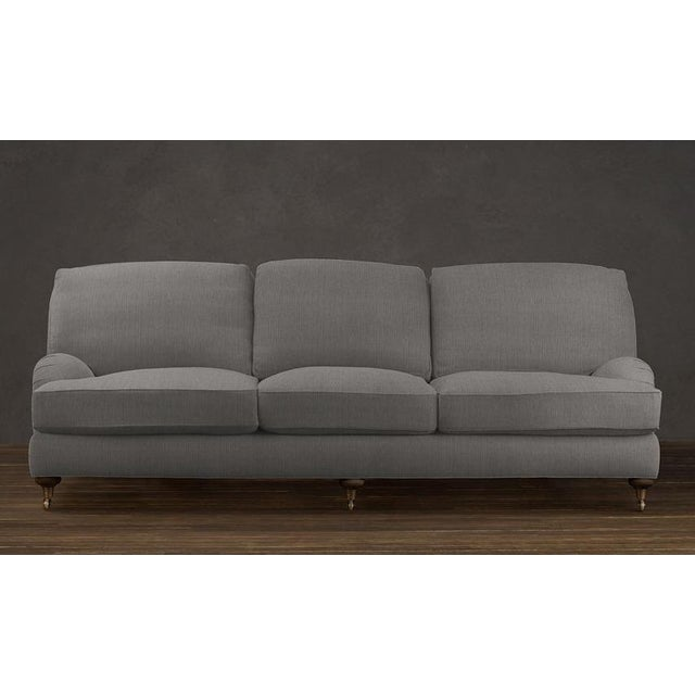 "Beautiful low-profile English Roll Arm sofa from Restoration Hardware. Upholstered in 100% cotton ""Army Duck"" fabric in..."