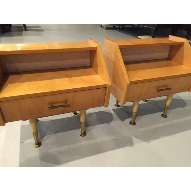 A beautiful pair of French Art Deco sycamore nightstands with one drawer and parchment.