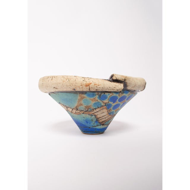 An organic clay vase/planter that inspires the earth tones with aquatic and celestial sky calming colors is a raw and...