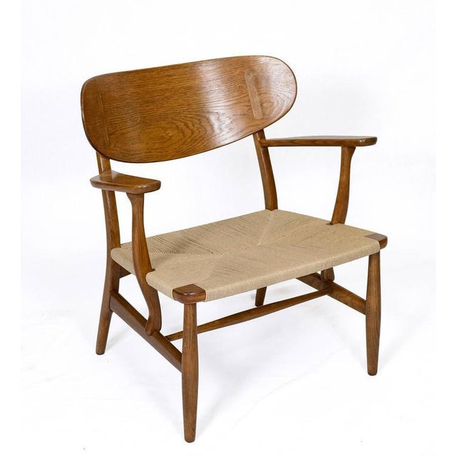 Hans Wegner CH-22 lounge chair designed in 1951 and produced by Carl Hansen & Son. Store formerly known as ARTFUL DODGER INC