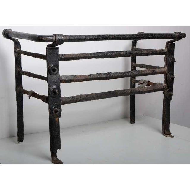 A large, rare and well used Dutch iron fire grate. One basket bar is missing, in original used condition. Great patina....