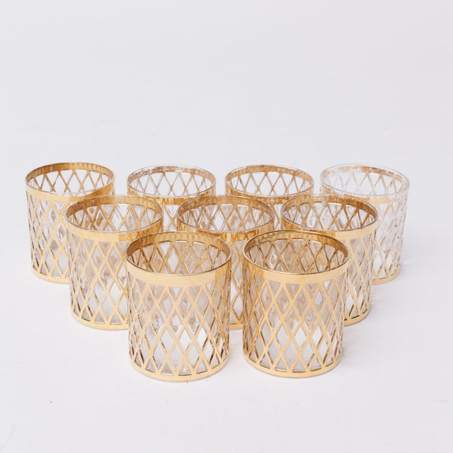 Set of vintage glasses with gold net pattern and goldrim. Makers mark with a 'C' and arrow on bottom. Offered as a set of...