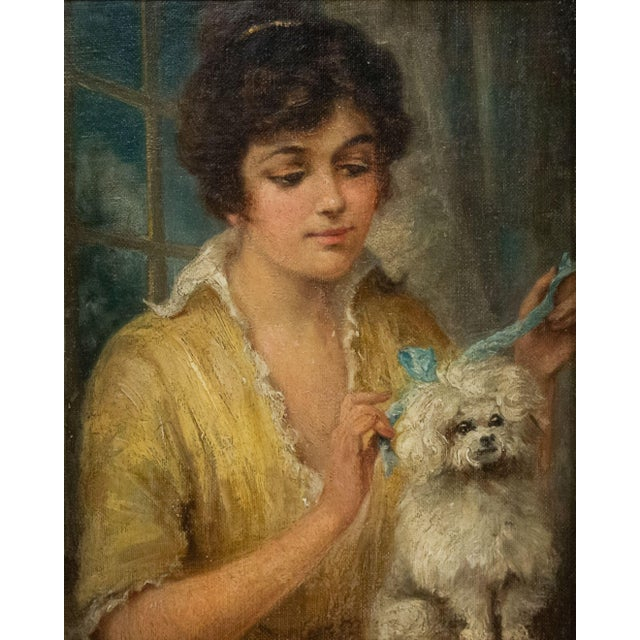French Victorian (19/20th Cent) oil painting portrait of a lady and French poodle with blue bow in walnut and ebonized frame.