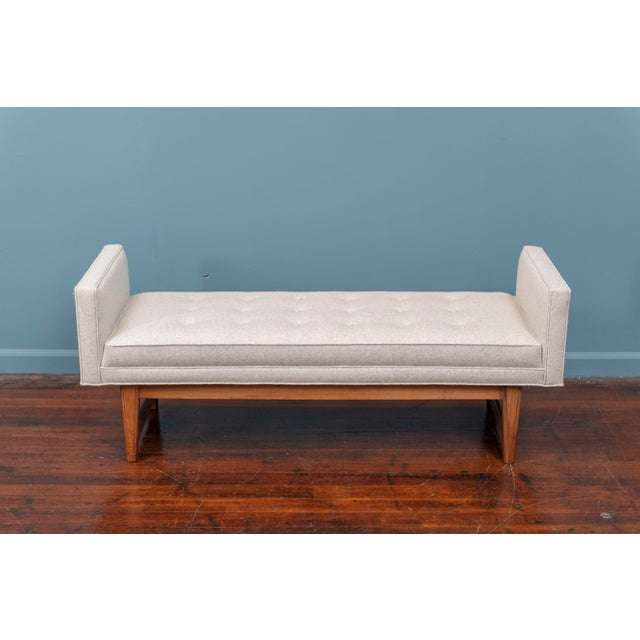 Mid-Century Modern bench by Selig, newly upholstered in a light gray/oatmeal wool felt on a walnut frame. In very good...