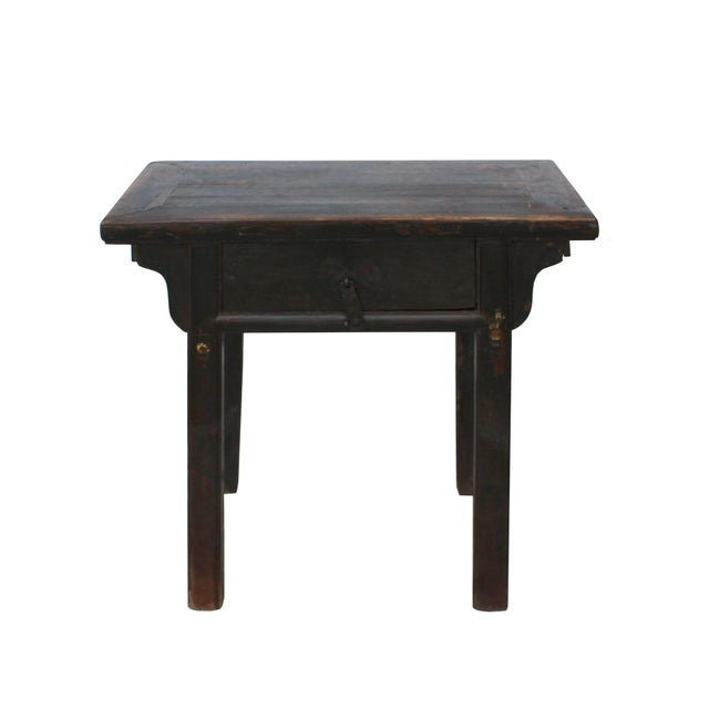 This is a side table restored in distressed rustic brown wear out patina finish. The drawer is decorated with iron...