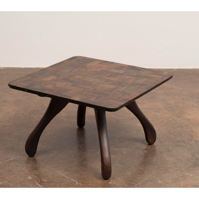 A stunning side table, known as the Cuerno table, by Don Shoemaker with a cocobolo (rosewood) parquetry top and bocote...