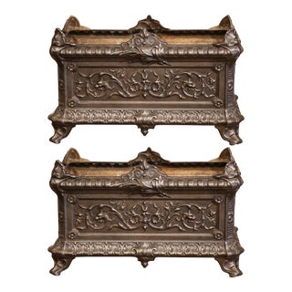 Pair of 19th Century French Polished Iron Outdoor Jardinières With Raised Decors For Sale