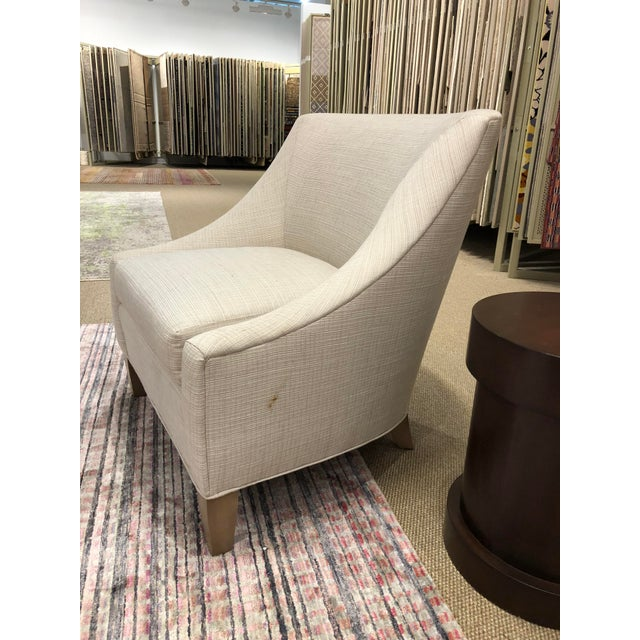 Syosset floor sample of Abigail upholstered club chair. Tight back with loose ultra crown seat cushion and tapered wooden...