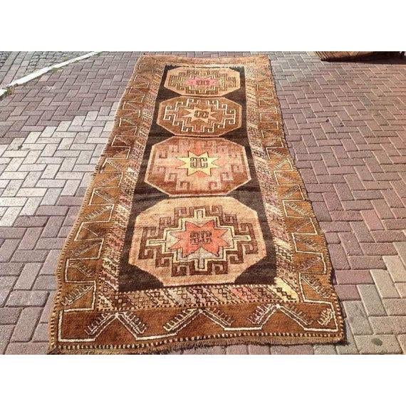 This beautiful, vintage, hand knotted Turkish rug is approximately 70 years old. It is handmade of very fine quality hand...