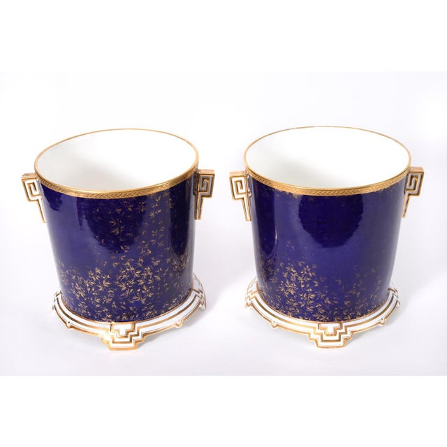 Late 19th century matching pair of English porcelain Wedgwood wine coolers / ice bucket. These coolers are just exquisite...