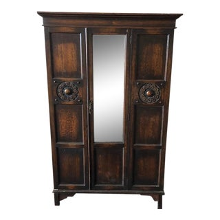 Early 20th Century Folk Art Carved Armoire/Wardrobe With Beveled Mirror Door For Sale