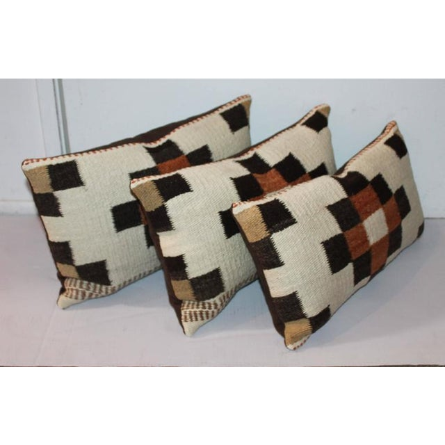 These pillows are from a Navajo Saddle blanket. The two larger pillows are 19 x 12 and the smaller pillow is 19 x 10....