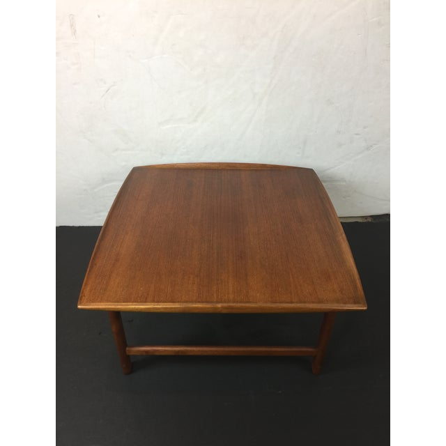 Beautiful Modern Danish Style square shape coffee table. Comes with nicely carved shape like tray on four sides. Has two...