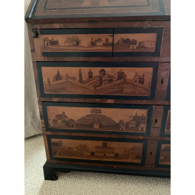 Be still my heart! This beautiful Northern Italian 18th century Italian desk is decorated with beautiful executed...