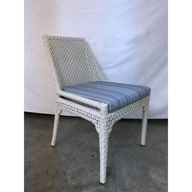 The Tangier Dining Side Chair is a first quality market sample that features a Leisure Plush Seat Cushion. It comes in a...