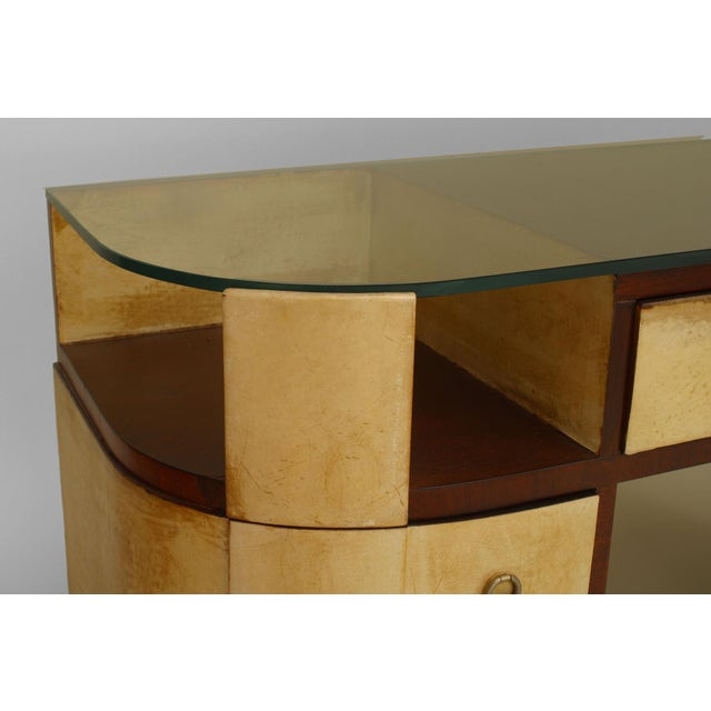 "French Art Deco mahogany and parchment veneered ""D"" shaped dressing table desk with a glass top over sides of an open..."