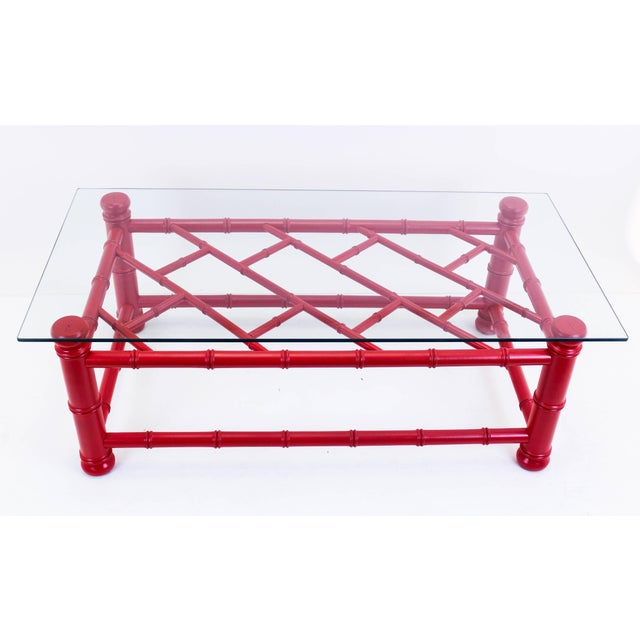 Beautiful vintage Palm Beach style coffee table with fretwork design and glass top. Nicely painted in satin gloss coral...