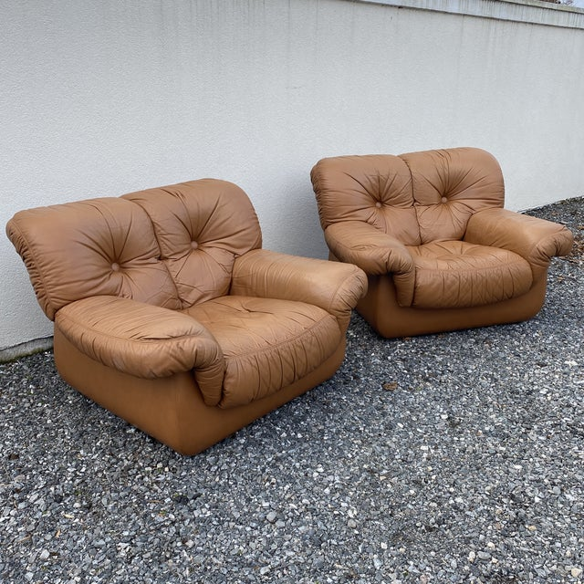 Great pair of oversized Italian leather club chairs in tobacco brown grain leather. Super comfy. No tears or rips. Tiny...