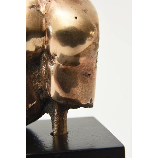 This bronze sensual tabletop or desk bronze and wood abstract sculpture is Mid-Century. It is Austrian. From all angles it...