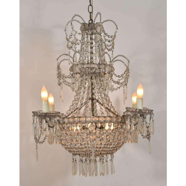 Seven-light crystal chandelier: three-tier fixture created circa 1860-1880 by the Royal Factory of Glass and Crystal of La...