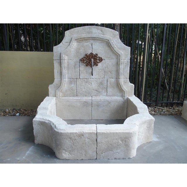 This elegant wall fountain from Provence has been hand carved in Estaillade limestone. The back has a domed top with...