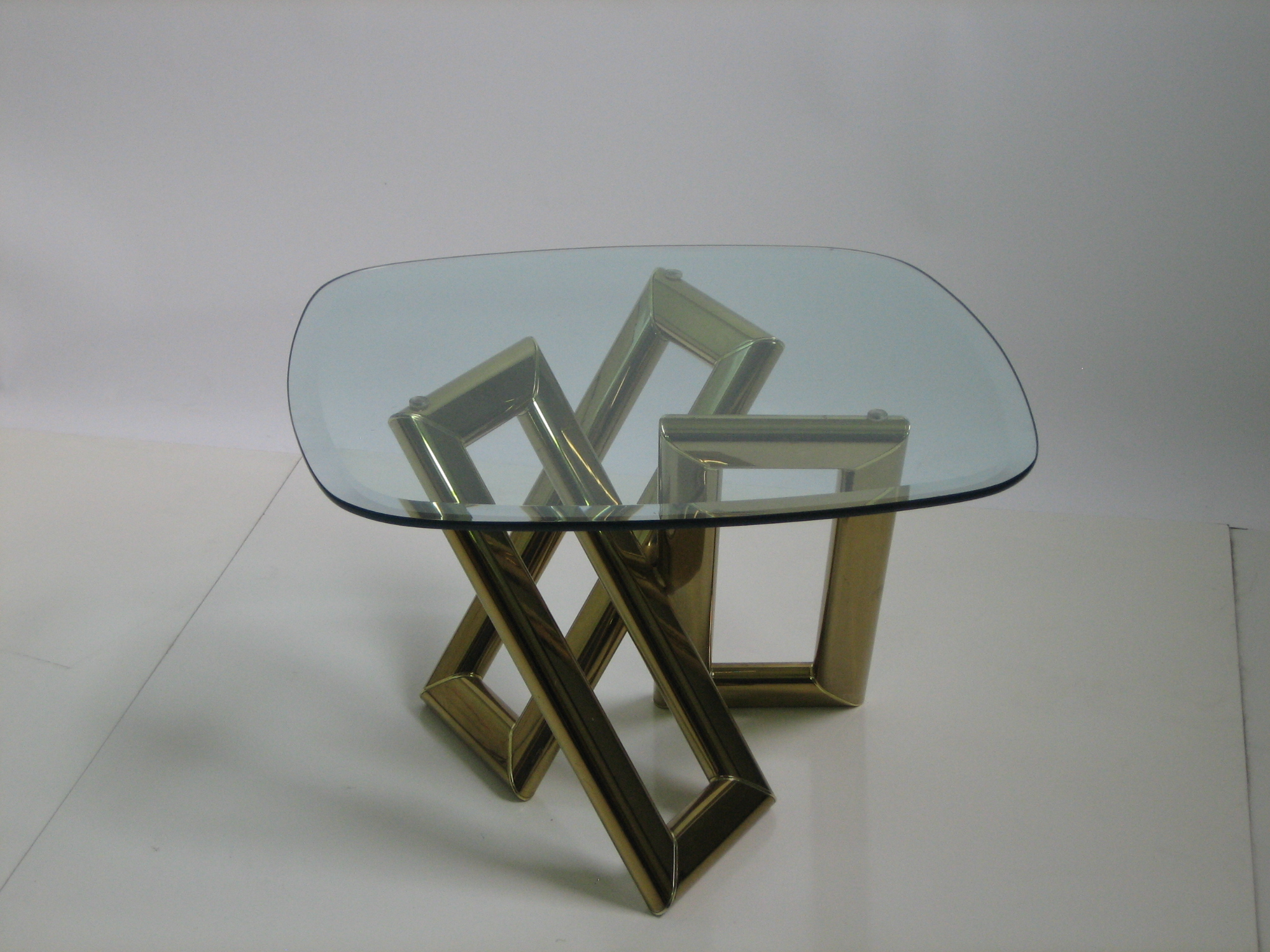 Very Sculptural Metal Glass Top Corner Or Coffee Table, Metal Base With A  Brass Finish
