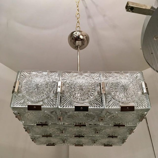 A 1960s Bohemian cut crystal pendant or flush ceiling light by Kamenicky Senov. The light is composed of thick textured...