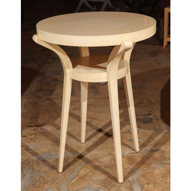 Restored sculptural 1990s side table refinished in a faux painted parchment finish.