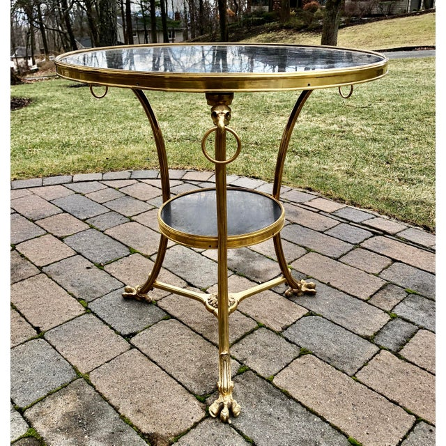 Louis XVI style 2 tier bronze black marble top gueridon with eagle heads and feet.
