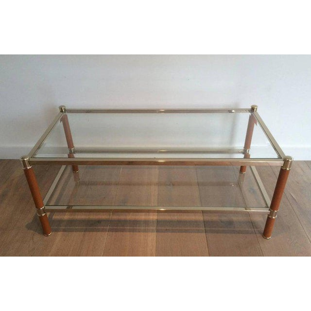 Gilt brass coffee table by Lancel Paris with leather wrapped legs. French, circa 1970.