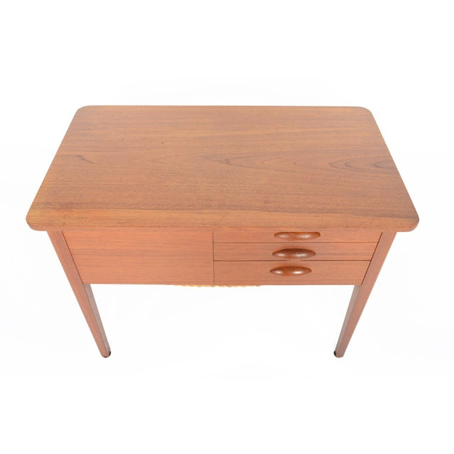 This Danish modern mid century sewing box in teak offers excellent storage! A large side drawer and three small drawers...