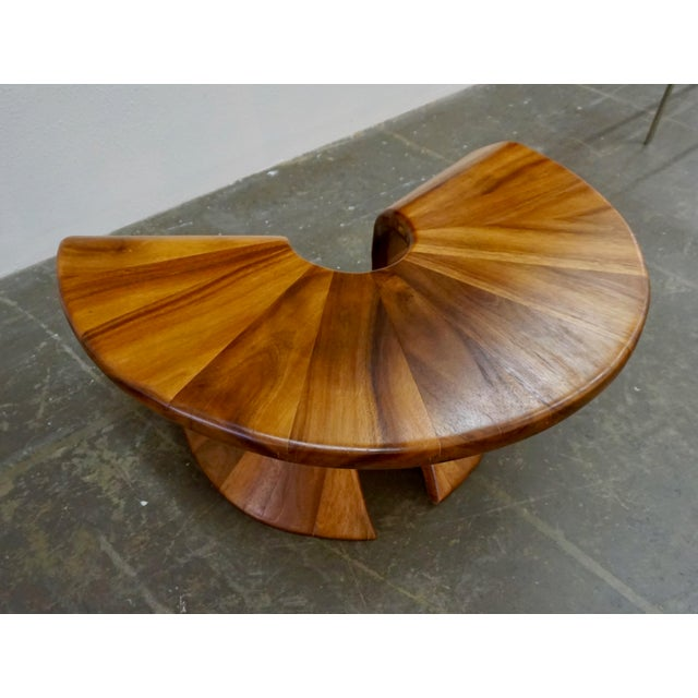 "1980's Hand crafted coffee or side table signed ""Ridman 2/81. Laminated walnut in an interesting semi-oval shape."