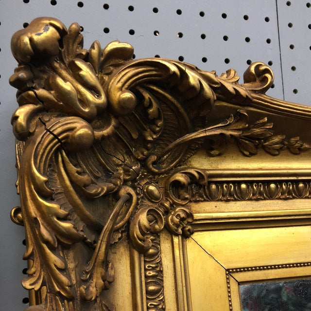 Absolutely stunning antique floor mirror with gorgeous carving and gilded acanthus leaf details. Perfect for standing in...