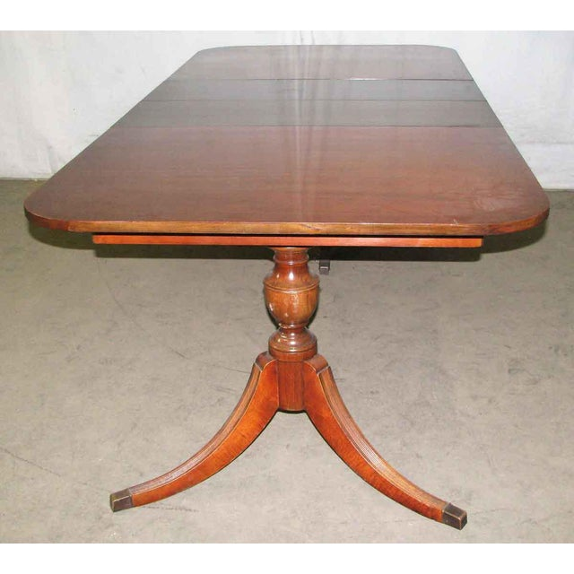 Mahogany Duncan Phyfe extendable table. It measures five feet when closed and extends to 7.5 feet when opened. There is...