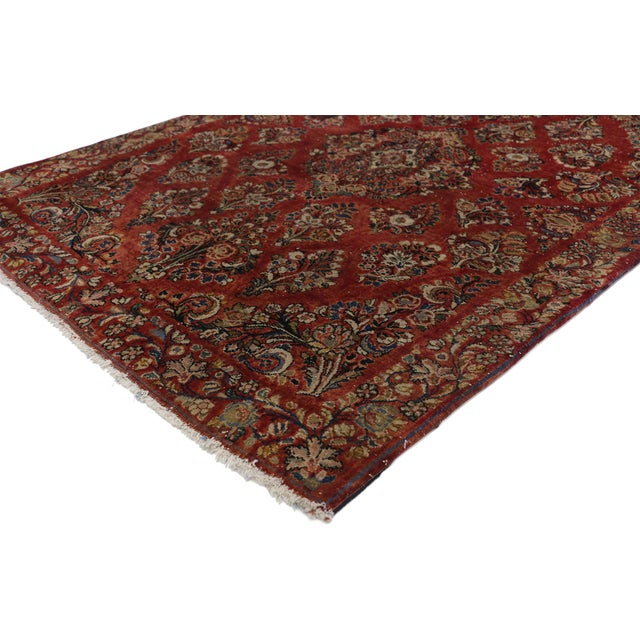 76921 Antique Sarouk Persian Rug with Old World Victorian Style. Immersed in Persian history, this highly desirable...