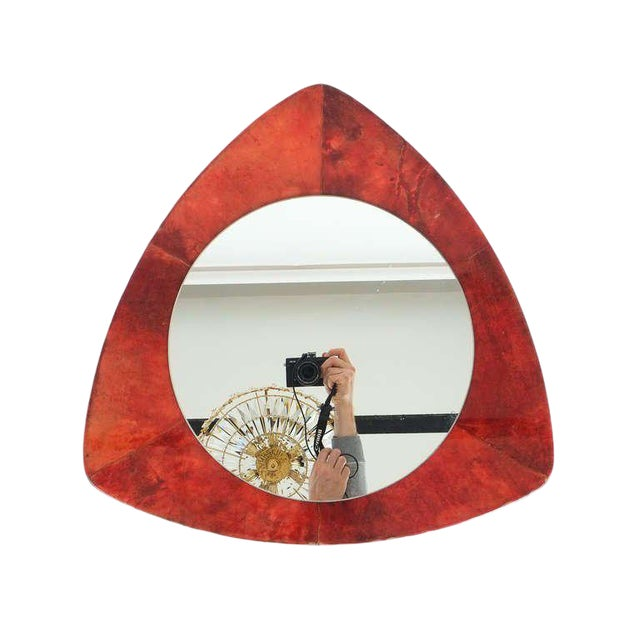 Nice 23 inch mirror by Aldo Tura made from dyed and lacquered goatskin (parchment). It has got an unusual shape and can be...