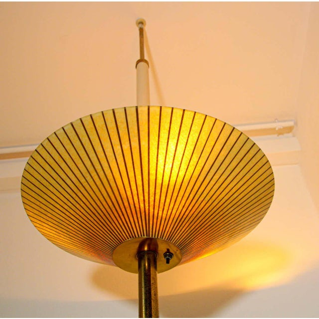 Vintage mid-century lamp from the 1950s consists of a large parchment disk shade plate on top with three lights and two...