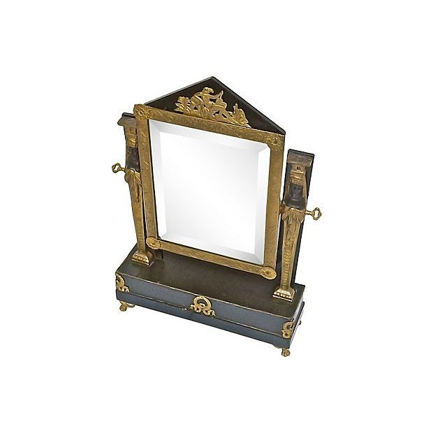 An antique 19th century French Empire style vanity mirror with adjustable flip mirror with classical accents. The mirror...
