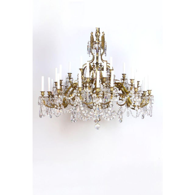 Gilt Bronze with aged patina. Beaux Arts Chandelier with glittery crystals.