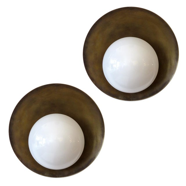 """Elegant custom """"Concha"""" wall light designed by Gallery L7, opaline glass shade on a patinated raw brass disc, multiples..."""