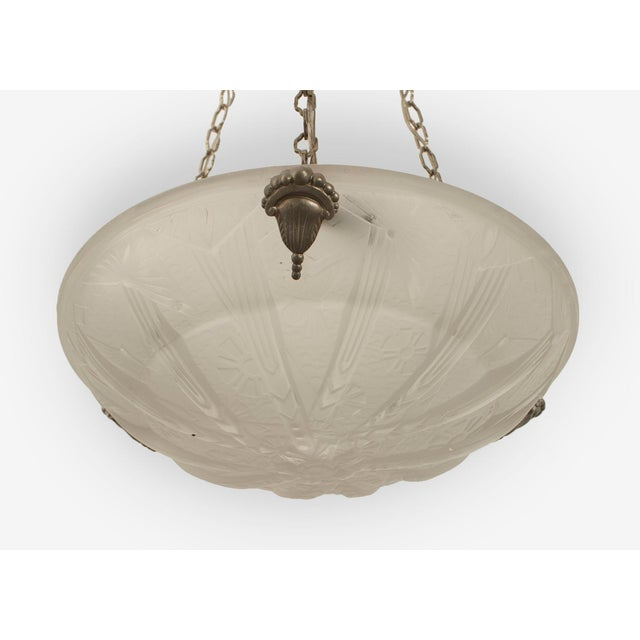 French Art Deco (circa 1925) round pendant form frosted glass chandelier with a molded geometric design & sunburst bottom...