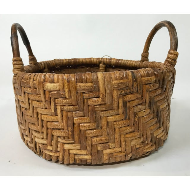 Round woven wicker basket featuring great pattern and strong wooden handles. This would make a great catchall, decorative...